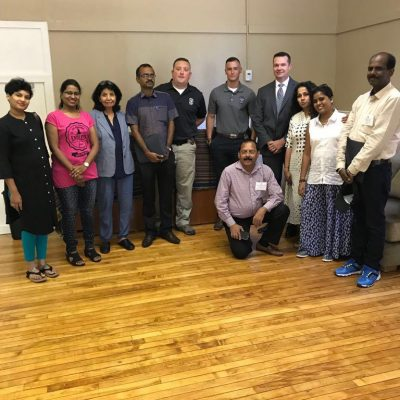 Our Seminar Level Hindi Interpreters interpreting for a group from India meeting with Police Dept officeers in Louisville handling trafficking and gender based violence